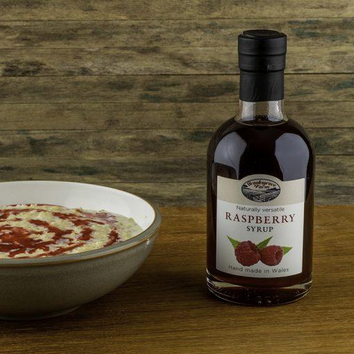 Raspberry syrup on porridge